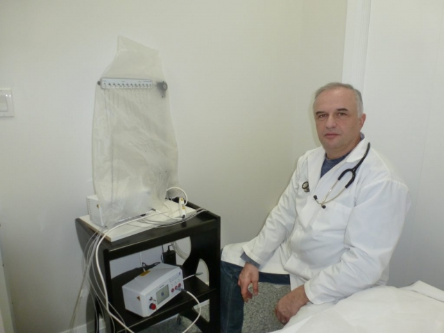 Health Practitioner inside the Laser Treatment Room